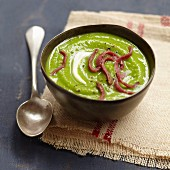 Cream of pea soup with diced duck fillet