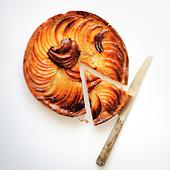 Cutting a slice of apple pie