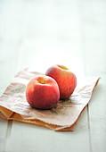 Peaches on a brown pepper bag