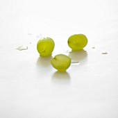 Three white grapes on a white background