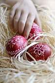 Nest of red Easter eggs