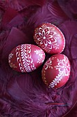 Decorated easter eggs and pink feathers