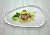 Marrowbone in sauce with steamed vegetables