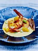 Shrimps, carrots and leeks in Kari Gosse cream sauce, fried buckwheat galette