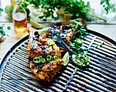 Barbecued chicken, herb and green chili pepper sauce