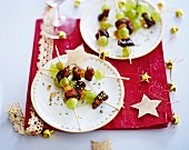 Duck in honey and crushed pistachios, candied orange and white grape brochette