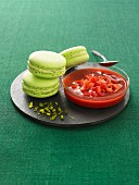 Pistachio Macarons with strawberry coulis