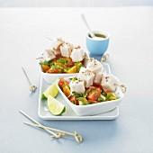 Cherry tomato salad with parsley and lemon, mini cod brochettes