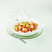Watermelon, yellow cherry tomato and diced mozzarella salad
