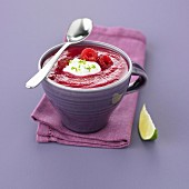 Cold beetroot soup with raspberries and lime cream