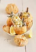 Sardine, rosemary, confit citrus and honeydew melon Chouquette-style mini buns