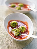 Strawberry soup with ricotta balls topped with crushed pistachios