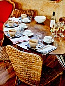Table set with glasses and bottle of white wine