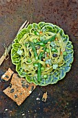 Tagliatelles with green asparagus, broad beans, , cheese and herbs, squash seed crackers