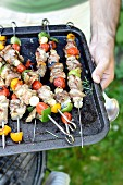 Pork and vegetable brochettes on the barbecue