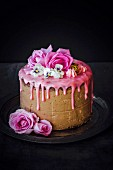 Chocolate layer cake topped with rose-flavored icing