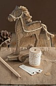 Reel of string, wooden horse and labels