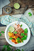 Baked salmon with mango, carrots, lime and golden and black sesame seeds