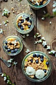 Mascarpone cream with mango, blueberries and crumble