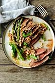 Beef Tagliata with asparagus, rocket lettuce, pine nuts and parmesan vinaigrette