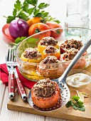 Yellow and red tomatoes stuffed with beef