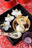 Almond milk ice cream, green tea powder, cherries and crushed sesame caramel