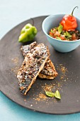 Mackerel fillets with crisp spicy skin, crushed tomatoes, chili pepper and mint