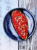 Roasted aubergine with tomatoes and pine nuts
