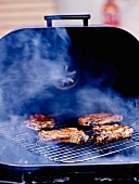 Cooking pork chops on the barbecue