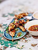 Satay chicken brochettes, chili pepper sauce with peanuts