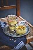 Jars of apricot and pistachio flans