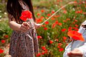 Children holding poppies