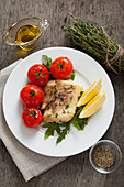 Hake with fresh thyme and baked tomatoes