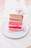 Slice of pink and white layer cake