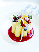 Pineapple cannelonis with summer fruit and coulis