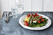 Cod fillet in herb crust, samphire, green asparagus and roasted tomatoes