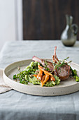 Grilled lamb chops, mashed broccolis and spring carrots
