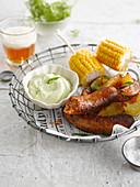 Sausage, crispy potatoes, sweet corn and basil aïoli