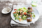 Chicken meatball and courgette brochette, white haricot bean mixed salad