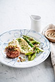 Turkey Paupiette with onions, mashed potatoes with mustard and herbs, green asparagus