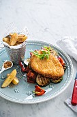 Schnitzel, grilled vegetables and potatoes with paprika