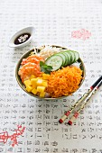 Rice vermicelli, carrot, mango, cucumber, beansprout and gambas Asian Buddha bowl