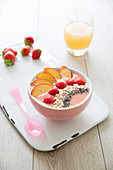 Peach-strawberry, porridge and chia bean smoothie bowl