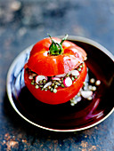 Tomato stuffed with lentil and radish salad