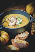 Bowl Of Squash Soup With Faisselle,Croutons And Spices