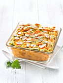 Carrot And Parsley Clafoutis Sprinkled With Thinly Sliced Almonds