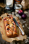 Plum and oatmeal quatre-quarts cake