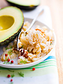 Avocado and crab meat, cauliflower and raisin salad