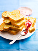 Slices of brioche, strawberry and wild strawberry jam