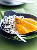 Pike quenelles in Nantua sauce with white and wild rice